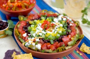 Macho Nachos: Jeff's Natural jalapeño peppers and sliced hot cherry peppers add zip to this party appetizer platter.